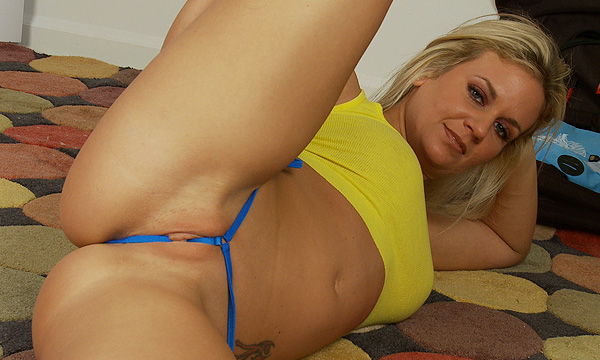 Angel Lee stretches wearing a micro thong string