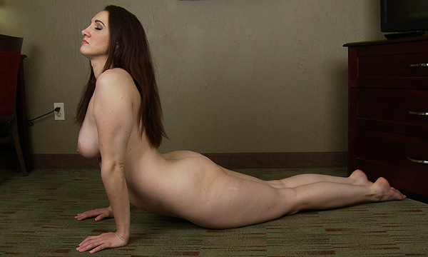 Angelique Kithos performs yoga in the nude