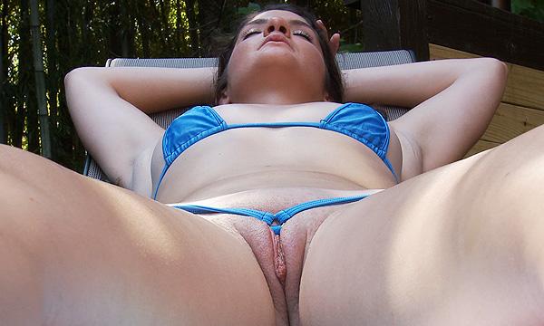 Crotch shot of Arielle Lane as she sunbathes in a micro bikini
