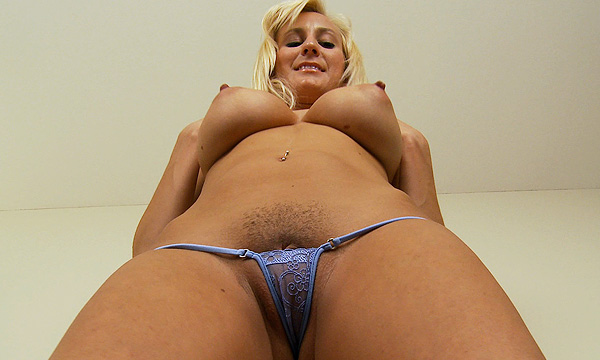 Up-shot of a topless Autumn Westin in a micro thong