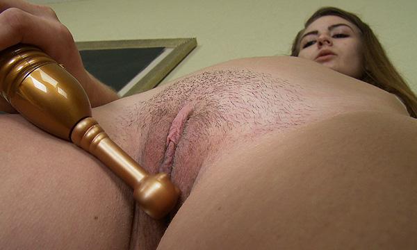 Brandi X.E. masturbates using a clit stimulator sex toy