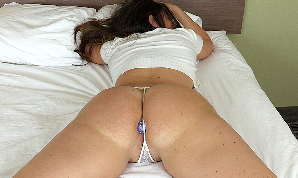 Brittany Shae sleeping and wearing a jeweled anal plug