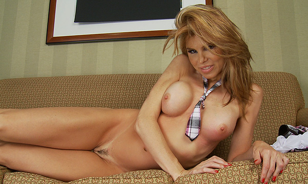 Candle Boxxx poses nude on a couch
