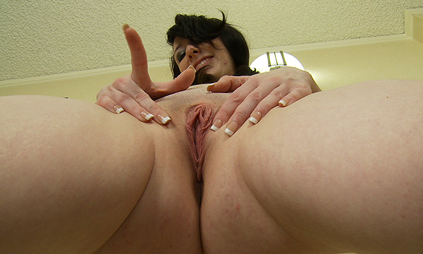 Dakota Charms spreads her pussy open