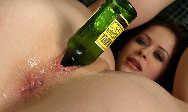 Emily Addison in piledriver position masturbating