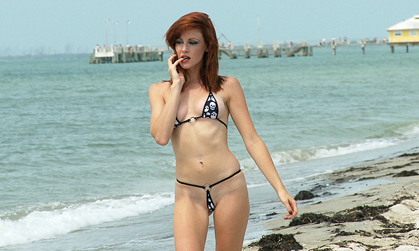Hollis Ireland in a micro bikini on the beach