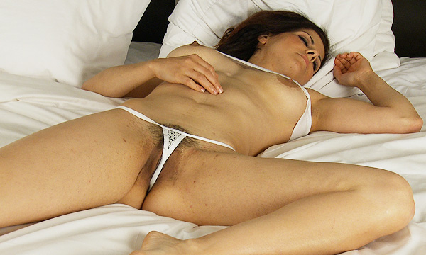 Jazmine sleeps wearing a tank top and white lace micro thong
