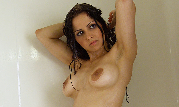 Jazmine showers and lathers up her breasts