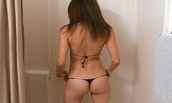 Jenni Lee shows off her booty in a micro bikini