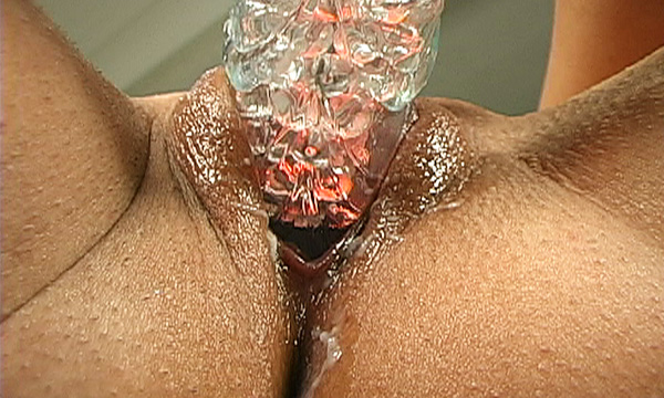 Close-up of a sex toy filling Jordan Bentley's pussy