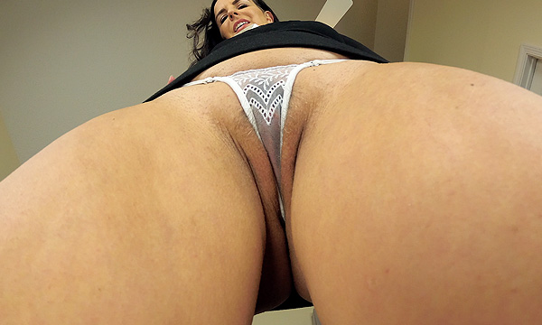 Upskirt shot of Kobe Lee revealing a sheer white lace micro thong