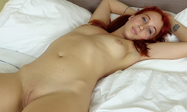 Luna Lain laying in bed nude