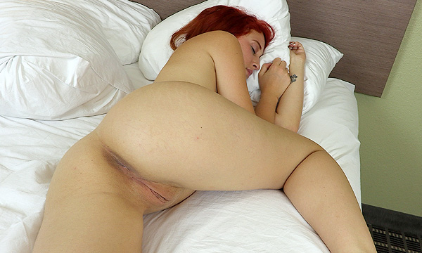 Luna Lain sleeping nude with her leg pulled up towards her body