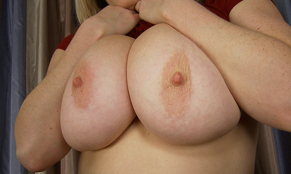Maggie Green shows off her large breasts