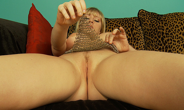 Malloy Martini lifts her thong to reveal her pussy